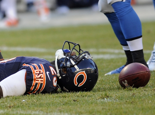 Nov 10, 2013; Chicago, IL, USA; Chicago Bears wide receiver Devin Hester (23) after he gets tackled by a Lions player at Soldier Field. Mandatory Credit: Matt Marton-USA TODAY Sports