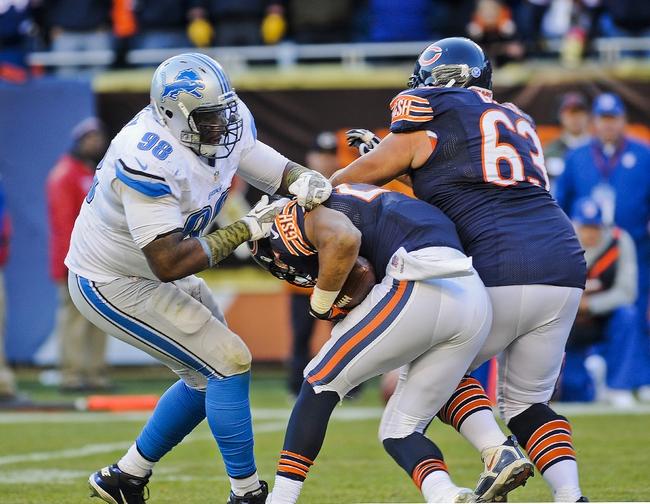 Nov 10, 2013; Chicago, IL, USA;  Detroit Lions defensive tackle Nick Fairley (98) sacks Chicago Bears quarterback Josh McCown (12) in the 4th quarter at Soldier Field. Mandatory Credit: Matt Marton-USA TODAY Sports