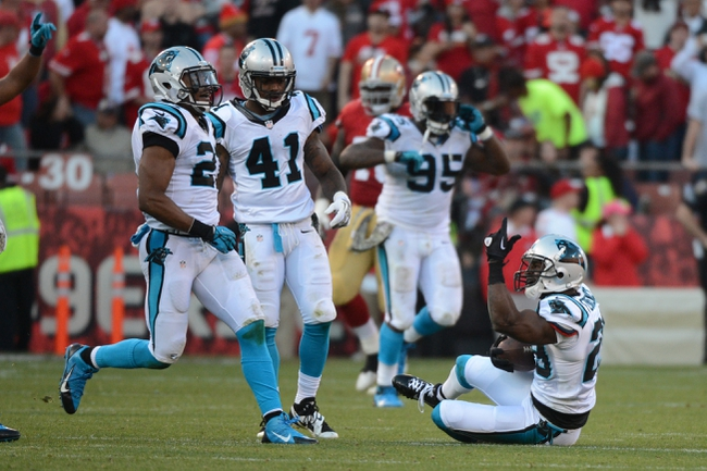November 10, 2013; San Francisco, CA, USA; Carolina Panthers cornerback Drayton Florence (29) celebrates after intercepting the ball during the fourth quarter against the San Francisco 49ers at Candlestick Park. The Panthers defeated the 49ers 10-9. Mandatory Credit: Kyle Terada-USA TODAY Sports
