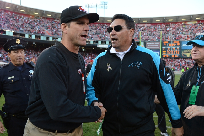 November 10, 2013; San Francisco, CA, USA; San Francisco 49ers head coach Jim Harbaugh (left) shakes hands with Carolina Panthers head coach Ron Rivera (right) after the game at Candlestick Park. The Panthers defeated the 49ers 10-9. Mandatory Credit: Kyle Terada-USA TODAY Sports