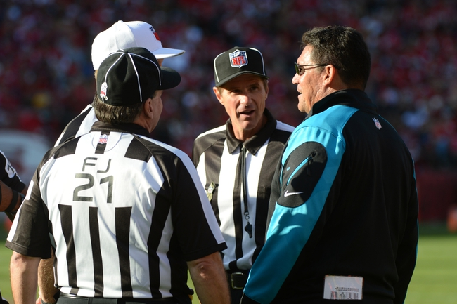 November 10, 2013; San Francisco, CA, USA; Carolina Panthers head coach Ron Rivera (far right) talks to the referees against the San Francisco 49ers during the third quarter at Candlestick Park. The Panthers defeated the 49ers 10-9. Mandatory Credit: Kyle Terada-USA TODAY Sports