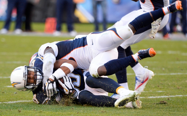 Nov 10, 2013; San Diego, CA, USA;  San Diego Chargers running back Ryan Mathews (24) is driven to the turf by Denver Broncos cornerback Kayvon Webster (36) during 3rd quarter action at Qualcomm Stadium. Mandatory Credit: Robert Hanashiro-USA TODAY Sports