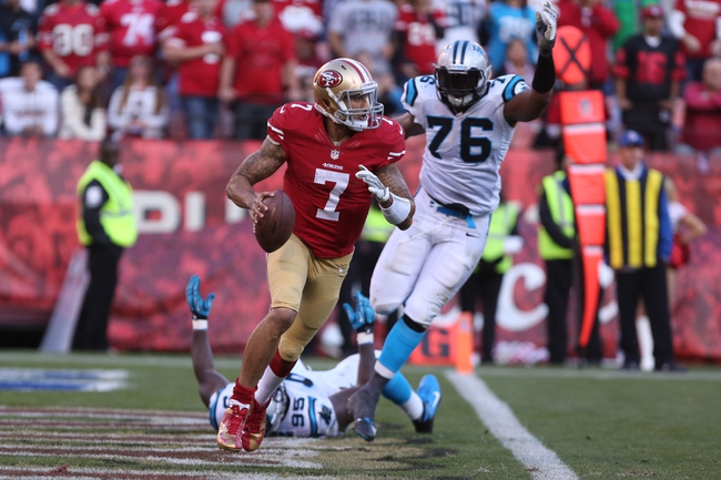 Nov 10, 2013; San Francisco, CA, USA; San Francisco 49ers quarterback Colin Kaepernick (7) escapes Carolina Panthers defensive end Charles Johnson (95) and defensive end Greg Hardy (76) during the fourth quarter at Candlestick Park. The Carolina Panthers defeated the San Francisco 49ers 10-9. Mandatory Credit: Kelley L Cox-USA TODAY Sports
