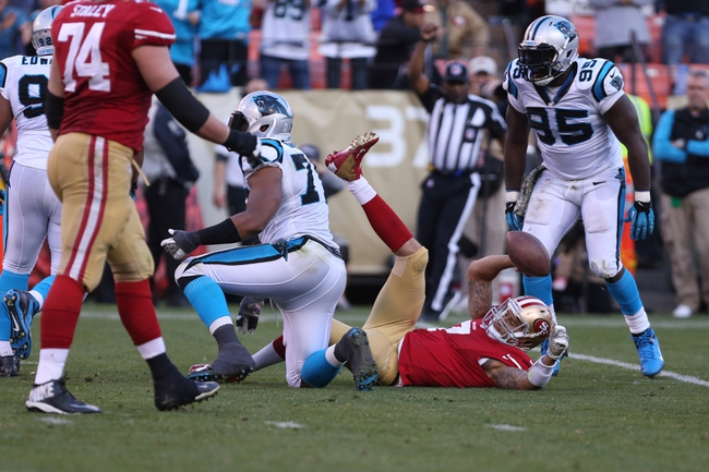 Nov 10, 2013; San Francisco, CA, USA; San Francisco 49ers quarterback Colin Kaepernick (7) is sacked by Carolina Panthers defensive end Greg Hardy (76) during the fourth quarter at Candlestick Park. The Carolina Panthers defeated the San Francisco 49ers 10-9. Mandatory Credit: Kelley L Cox-USA TODAY Sports