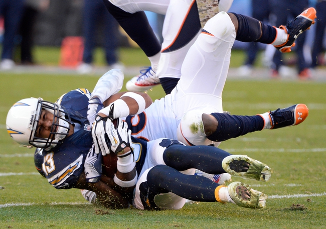 Nov 10, 2013; San Diego, CA, USA;  San Diego Chargers wide receiver Keenan Allen (13) is driven to the turf by Denver Broncos cornerback Kayvon Webster (36) during 3rd quarter action at Qualcomm Stadium. Mandatory Credit: Robert Hanashiro-USA TODAY Sports