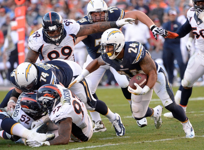 Nov 10, 2013; San Diego, CA, USA;  San Diego Chargers running back Ryan Mathews (24) tries to get around the corner against the Denver Broncos during second half action at Qualcomm Stadium. Mandatory Credit: Robert Hanashiro-USA TODAY Sports