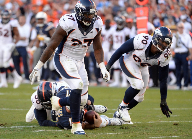 Nov 10, 2013; San Diego, CA, USA; Denver Broncos defensive end Malik Jackson (97) and Denver Broncos defensive end Shaun Phillips (90) celebrate a second half sack of San Diego Chargers quarterback Philip Rivers (17) at Qualcomm Stadium. Mandatory Credit: Robert Hanashiro-USA TODAY Sports