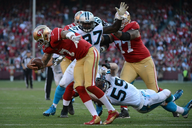 November 10, 2013; San Francisco, CA, USA; Carolina Panthers middle linebacker Luke Kuechly (59) sacks San Francisco 49ers quarterback Colin Kaepernick (7) during the fourth quarter at Candlestick Park. The Panthers defeated the 49ers 10-9. Mandatory Credit: Kyle Terada-USA TODAY Sports