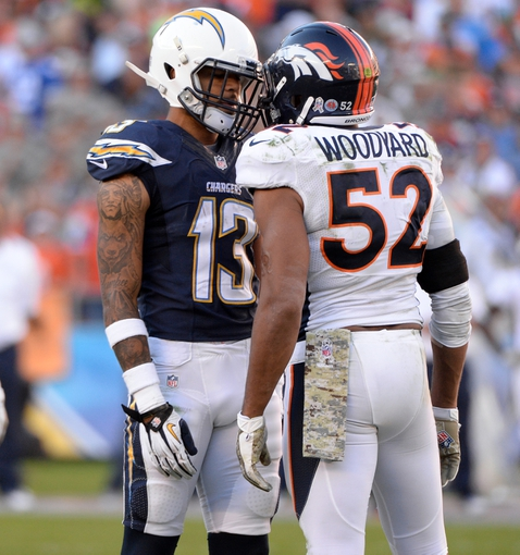Nov 10, 2013; San Diego, CA, USA; San Diego Chargers wide receiver Keenan Allen (13) and Denver Broncos outside linebacker Wesley Woodyard (52) go face-to-face after a third quarter play at Qualcomm Stadium. Mandatory Credit: Robert Hanashiro-USA TODAY Sports