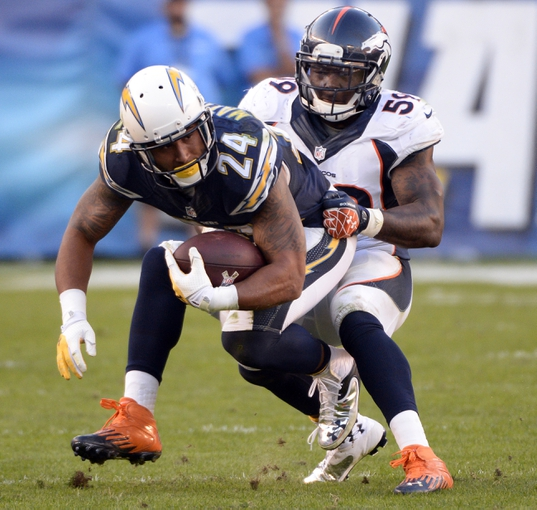 Nov 10, 2013; San Diego, CA, USA;  Denver Broncos outside linebacker Danny Trevathan (59) stops San Diego Chargers running back Ryan Mathews (24) after a short gain in the second half at Qualcomm Stadium. Mandatory Credit: Robert Hanashiro-USA TODAY Sports