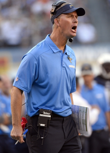 Nov 10, 2013; San Diego, CA, USA;  San Diego Chargers head coach Mike McCoy yells at referees during the second half against the Denver Broncos at Qualcomm Stadium. Mandatory Credit: Robert Hanashiro-USA TODAY Sports