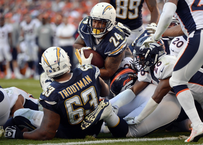 Nov 10, 2013; San Diego, CA, USA;  San Diego Chargers running back Ryan Mathews (24) scores a second half touchdown against the Denver Broncos at Qualcomm Stadium. Mandatory Credit: Robert Hanashiro-USA TODAY Sports