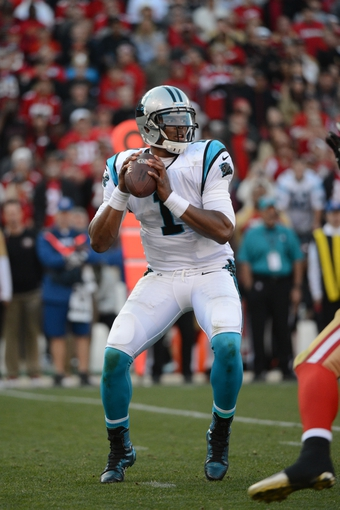 November 10, 2013; San Francisco, CA, USA; Carolina Panthers quarterback Cam Newton (1) passes the football against the San Francisco 49ers during the fourth quarter at Candlestick Park. The Panthers defeated the 49ers 10-9. Mandatory Credit: Kyle Terada-USA TODAY Sports