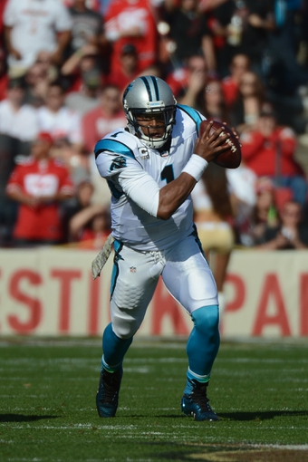 November 10, 2013; San Francisco, CA, USA; Carolina Panthers quarterback Cam Newton (1) runs with the ball against the San Francisco 49ers during the first quarter at Candlestick Park. Mandatory Credit: Kyle Terada-USA TODAY Sports