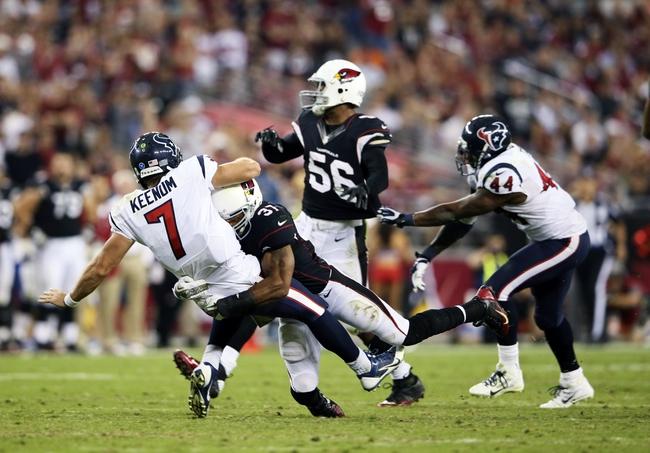 Nov 10, 2013; Phoenix, AZ, USA; Arizona Cardinals strong safety Yeremiah Bell (37) hits Houston Texans quarterback Case Keenum (7) during the game at University of Phoenix Stadium. Arizona won 27-24. Mandatory Credit: Kevin Jairaj-USA TODAY Sports