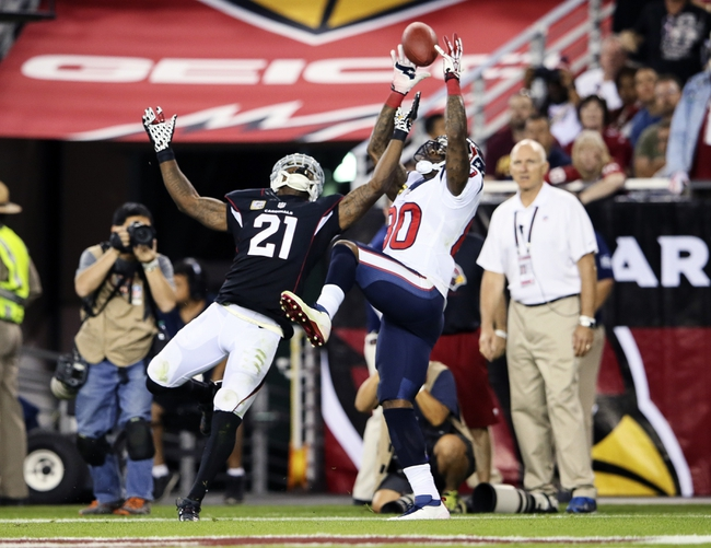 Nov 10, 2013; Phoenix, AZ, USA; Houston Texans wide receiver Andre Johnson (80) catches a touchdown pass over Arizona Cardinals cornerback Patrick Peterson (21) during the second half at University of Phoenix Stadium. Arizona won 27-24. Mandatory Credit: Kevin Jairaj-USA TODAY Sports