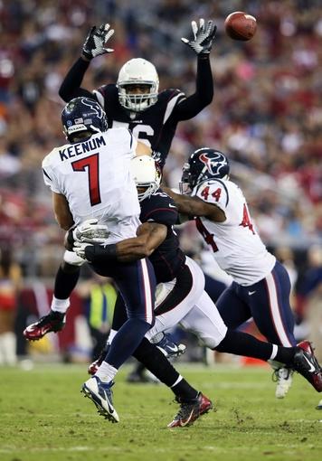 Nov 10, 2013; Phoenix, AZ, USA; Arizona Cardinals inside linebacker Karlos Dansby (56) deflects the pass of Houston Texans quarterback Case Keenum (7) during the game at University of Phoenix Stadium. Arizona won 27-24. Mandatory Credit: Kevin Jairaj-USA TODAY Sports