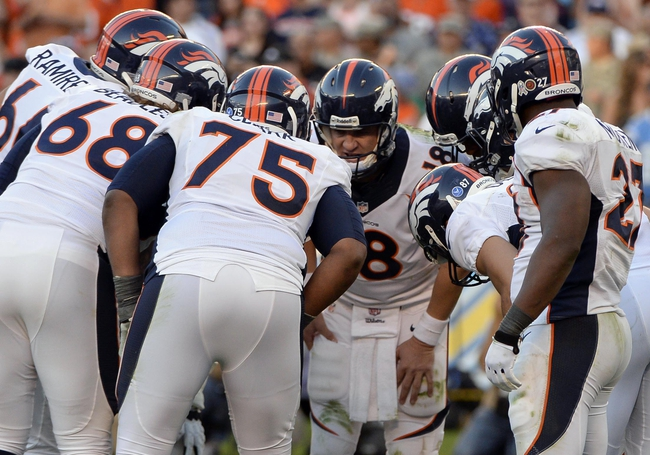 Nov 10, 2013; San Diego, CA, USA;  Denver Broncos quarterback Peyton Manning (18) calls a play in the huddle during the fourth quarter against the San Diego Chargers at Qualcomm Stadium. Mandatory Credit: Robert Hanashiro-USA TODAY Sports