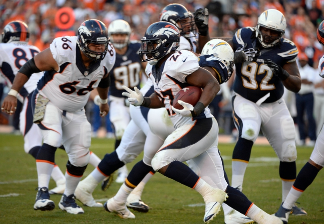 Nov 10, 2013; San Diego, CA, USA; Denver Broncos running back Knowshon Moreno (27) gets around the corner during second half action against the San Diego Chargers  at Qualcomm Stadium. Mandatory Credit: Robert Hanashiro-USA TODAY Sports