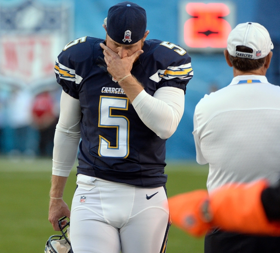 Nov 10, 2013; San Diego, CA, USA;  San Diego Chargers punter Mike Scifres (5) paces the sidelines as time winds down on the Chargers loss to the Denver Broncos at Qualcomm Stadium. Mandatory Credit: Robert Hanashiro-USA TODAY Sports