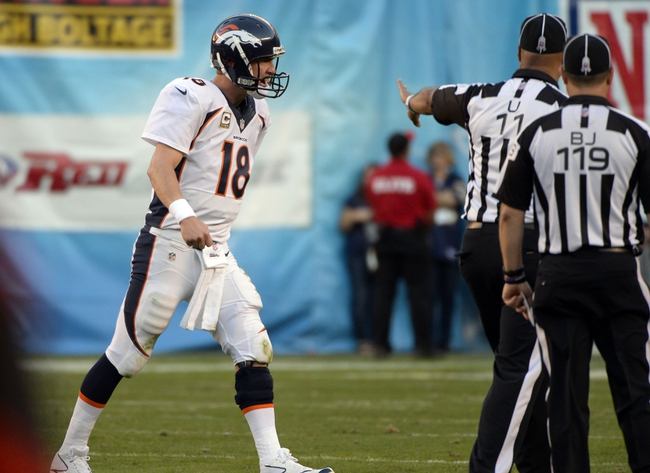 Nov 10, 2013; San Diego, CA, USA;  Denver Broncos quarterback Peyton Manning (18) yells at referees after there Broncos were accessed a timeout in the closing minutes of the fourth quarter against the San Diego Chargers at Qualcomm Stadium. Mandatory Credit: Robert Hanashiro-USA TODAY Sports