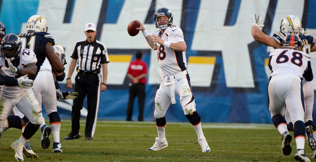 Nov 10, 2013; San Diego, CA, USA;  Denver Broncos quarterback Peyton Manning (18) throws a fourth quarter pass against the San Diego Chargers at Qualcomm Stadium. Manning was slightly injured on the play but continued. Mandatory Credit: Robert Hanashiro-USA TODAY Sports