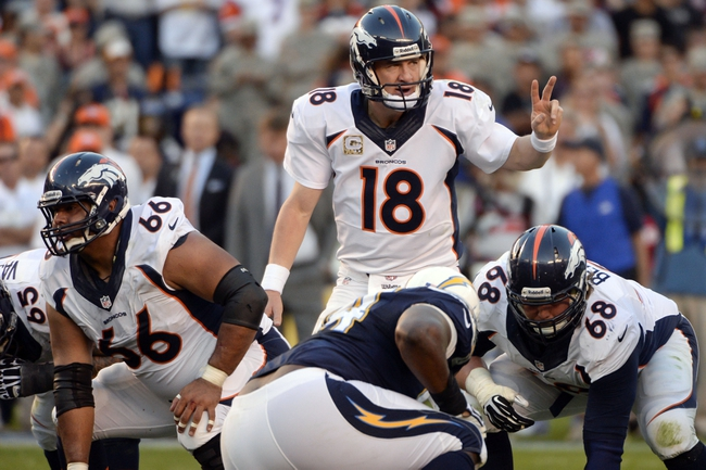 Nov 10, 2013; San Diego, CA, USA;  Denver Broncos quarterback Peyton Manning (18) calls a play at the line of scrimmage during the closing minute in the Broncos win over the San Diego Chargers at Qualcomm Stadium. Mandatory Credit: Robert Hanashiro-USA TODAY Sports
