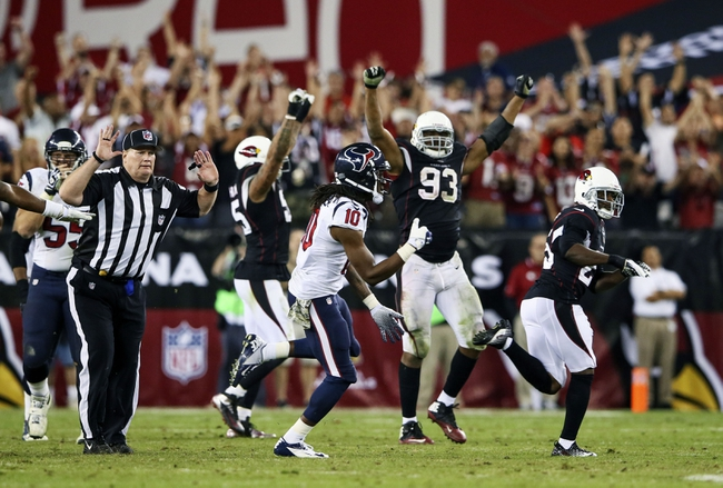 Nov 10, 2013; Phoenix, AZ, USA; Arizona Cardinals defensive end Calais Campbell (93) reacts during the game against the Houston Texans at University of Phoenix Stadium. Arizona won 27-24. Mandatory Credit: Kevin Jairaj-USA TODAY Sports