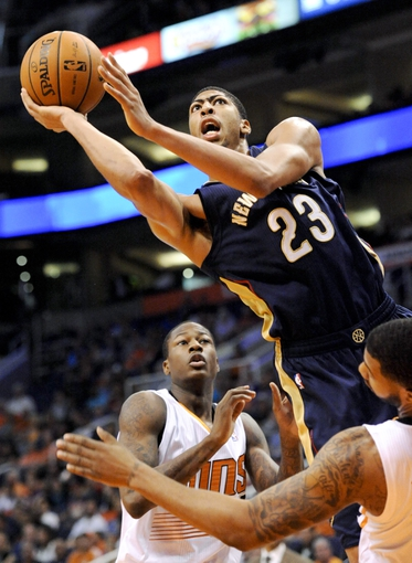 Nov 10, 2013; Phoenix, AZ, USA; New Orleans Pelicans power forward Anthony Davis (23) shoots the ball over Phoenix Suns power forward Markieff Morris (11) and shooting guard Archie Goodwin (20) during the third quarter at US Airways Center. The Suns beat the Pelicans 101-94. Mandatory Credit: Casey Sapio-USA TODAY Sports