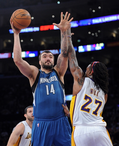 Nov 10, 2013; Los Angeles, CA, USA; Minnesota Timberwolves center Nikola Pekovic (14) shoots over Los Angeles Lakers center Jordan Hill (27) in the first half of the game at Staples Center. Mandatory Credit: Jayne Kamin-Oncea-USA TODAY Sports