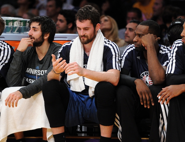 Nov 10, 2013; Los Angeles, CA, USA;   Minnesota Timberwolves point guard Ricky Rubio (9),  power forward Kevin Love (42) and small forward Shabazz Muhammad (15) on the bench in the first half of the game against the Los Angeles Lakers at Staples Center. Mandatory Credit: Jayne Kamin-Oncea-USA TODAY Sports