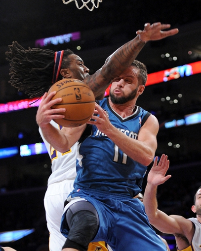 Nov 10, 2013; Los Angeles, CA, USA; Los Angeles Lakers center Jordan Hill (27) defends Minnesota Timberwolves point guard J.J. Barea (11) in the first half of the game at Staples Center. Mandatory Credit: Jayne Kamin-Oncea-USA TODAY Sports