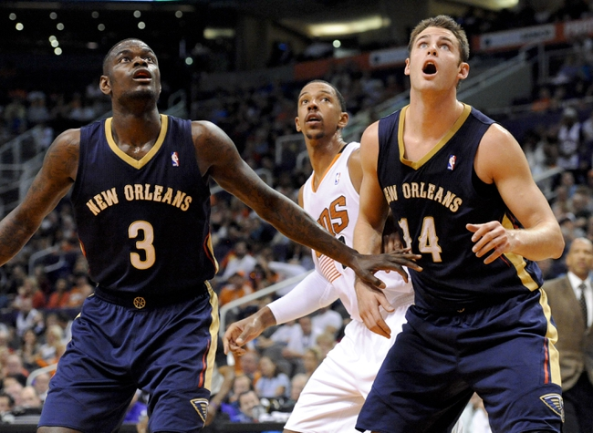 Nov 10, 2013; Phoenix, AZ, USA; New Orleans Pelicans shooting guard Anthony Morrow (3) and center Jason Smith (14) and Phoenix Suns power forward Channing Frye (8) battle for positioning during a free throw attempt during the second quarter at US Airways Center. Mandatory Credit: Casey Sapio-USA TODAY Sports