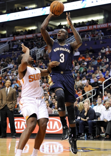 Nov 10, 2013; Phoenix, AZ, USA; New Orleans Pelicans shooting guard Anthony Morrow (3) shoots the ball as he is defended by Phoenix Suns shooting guard Dionte Christmas (25) during the fourth quarter at US Airways Center. The Suns beat the Pelicans 101-94. Mandatory Credit: Casey Sapio-USA TODAY Sports