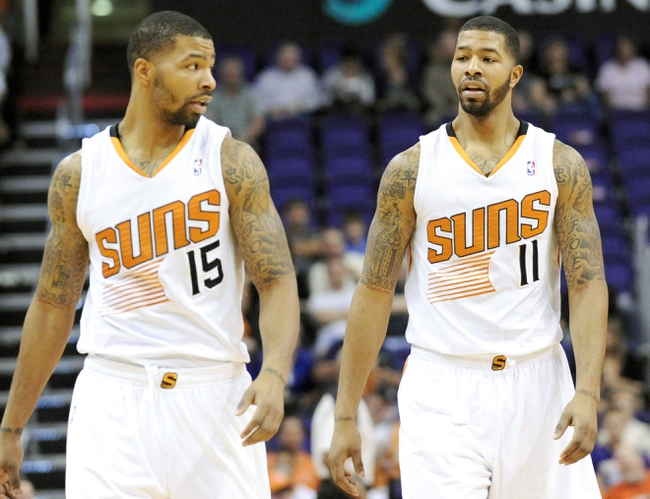 Nov 10, 2013; Phoenix, AZ, USA; Phoenix Suns power forward Marcus Morris (15) and power forward Markieff Morris (11) in between plays during the second quarter against the New Orleans Pelicans at US Airways Center. The Suns beat the Pelicans 101-94. Mandatory Credit: Casey Sapio-USA TODAY Sports
