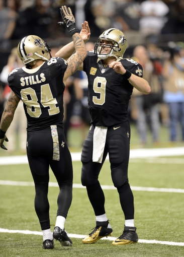 Nov 10, 2013; New Orleans, LA, USA; New Orleans Saints wide receiver Kenny Stills (84) celebrates his touchdown with quarterback Drew Brees (9) against the Dallas Cowboys during the fourth quarter at Mercedes-Benz Superdome. Mandatory Credit: John David Mercer-USA TODAY Sports