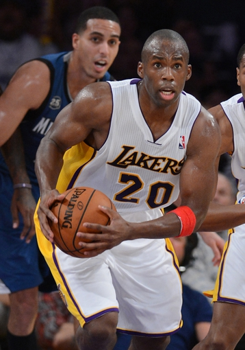 Nov 10, 2013; Los Angeles, CA, USA;  Los Angeles Lakers shooting guard Jodie Meeks (20) takes the ball down court as Minnesota Timberwolves shooting guard Kevin Martin (23) looks on in the second half of the game at Staples Center. Timberwolves won 113-90. Mandatory Credit: Jayne Kamin-Oncea-USA TODAY Sports