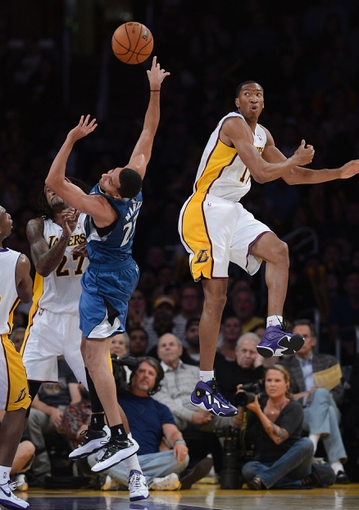 Nov 10, 2013; Los Angeles, CA, USA;  Los Angeles Lakers shooting guard Wesley Johnson (11) blocks a shot by Minnesota Timberwolves shooting guard Kevin Martin (23) in the second half of the game at Staples Center. Timberwolves won 113-90. Mandatory Credit: Jayne Kamin-Oncea-USA TODAY Sports