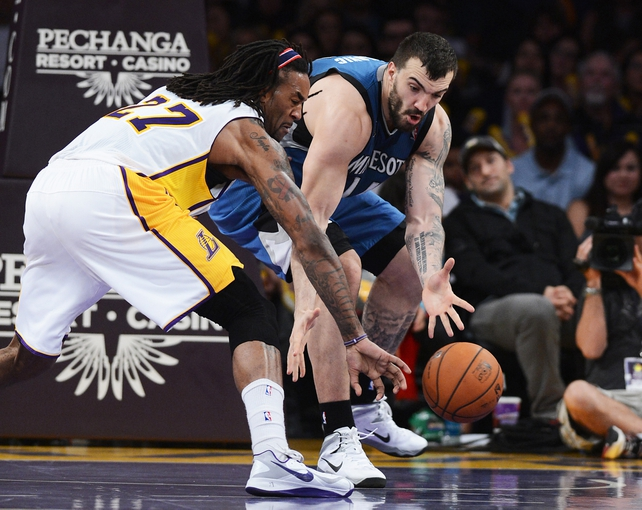 Nov 10, 2013; Los Angeles, CA, USA;  Minnesota Timberwolves center Nikola Pekovic (14) and Los Angeles Lakers center Jordan Hill (27) go for the ball in the second half of the game at Staples Center. Timberwolves won 113-90. Mandatory Credit: Jayne Kamin-Oncea-USA TODAY Sports