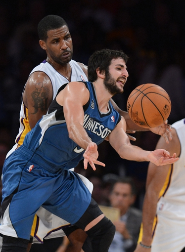 Nov 10, 2013; Los Angeles, CA, USA;  Los Angeles Lakers power forward Shawne Williams (3) guards Minnesota Timberwolves point guard Ricky Rubio (9) in the second half of the game at Staples Center. Timberwolves won 113-90. Mandatory Credit: Jayne Kamin-Oncea-USA TODAY Sports
