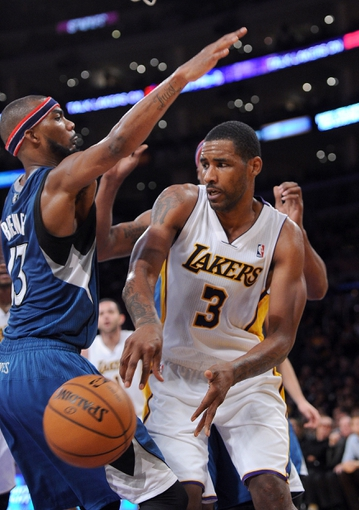 Nov 10, 2013; Los Angeles, CA, USA;  Los Angeles Lakers power forward Shawne Williams (3) passes around Minnesota Timberwolves small forward Corey Brewer (13) in the second half of the game at Staples Center. Timberwolves won 113-90. Mandatory Credit: Jayne Kamin-Oncea-USA TODAY Sports