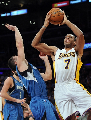Nov 10, 2013; Los Angeles, CA, USA;  Los Angeles Lakers small forward Xavier Henry (7) shoots over Minnesota Timberwolves point guard J.J. Barea (11) in the second half of the game at Staples Center. Timberwolves won 113-90. Mandatory Credit: Jayne Kamin-Oncea-USA TODAY Sports
