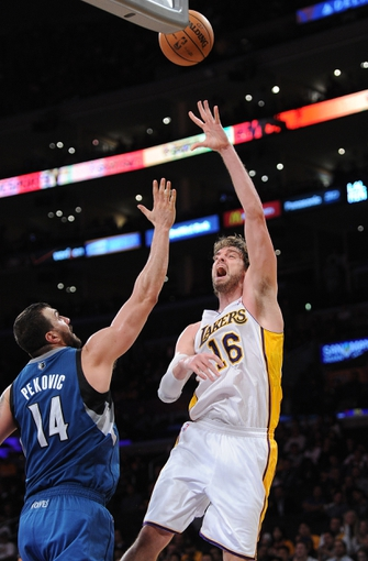 Nov 10, 2013; Los Angeles, CA, USA;  Los Angeles Lakers center Pau Gasol (16) shoots over Minnesota Timberwolves center Nikola Pekovic (14) in the second half of the game at Staples Center. Timberwolves won 113-90. Mandatory Credit: Jayne Kamin-Oncea-USA TODAY Sports