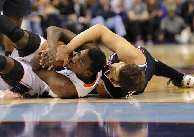 Nov 11, 2013; Charlotte, NC, USA; Charlotte Bobcats forward Michael Kidd Gilchrist (14) and Atlanta Hawks guard Kyle Korver (26) battle for the ball at Time Warner Cable Arena. Mandatory Credit: Sam Sharpe-USA TODAY Sports