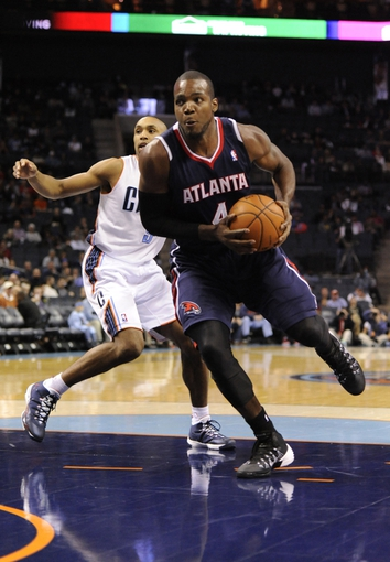 Nov 11, 2013; Charlotte, NC, USA; Atlanta Hawks forward Paul Millsap (4) dribbles the ball during the game against the Charlotte Bobcats at Time Warner Cable Arena. Mandatory Credit: Sam Sharpe-USA TODAY Sports