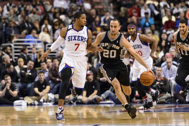 Nov 11, 2013; Philadelphia, PA, USA; San Antonio Spurs guard Manu Ginobili (20) is defended by Philadelphia 76ers guard Darius Morris (7) during the second quarter at Wells Fargo Center. Mandatory Credit: Howard Smith-USA TODAY Sports