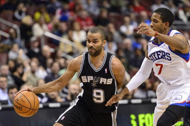 Nov 11, 2013; Philadelphia, PA, USA; San Antonio Spurs guard Tony Parker (9) is defended by Philadelphia 76ers guard Darius Morris (7) during the second quarter at Wells Fargo Center. Mandatory Credit: Howard Smith-USA TODAY Sports