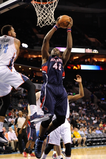 Nov 11, 2013; Charlotte, NC, USA; Atlanta Hawks forward center Elton Brand (42) drives to the basket against the Charlotte Bobcats during the game at Time Warner Cable Arena. Mandatory Credit: Sam Sharpe-USA TODAY Sports