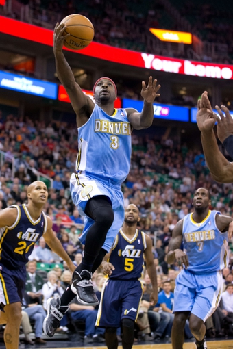 Nov 11, 2013; Salt Lake City, UT, USA; Denver Nuggets point guard Ty Lawson (3) goes to the basket during the first quarter against the Utah Jazz at EnergySolutions Arena. Mandatory Credit: Russ Isabella-USA TODAY Sports