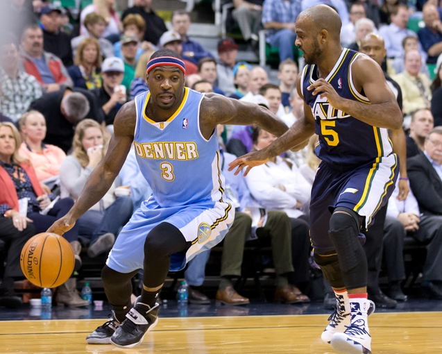 Nov 11, 2013; Salt Lake City, UT, USA; Denver Nuggets point guard Ty Lawson (3) attempts to dribble around Utah Jazz point guard John Lucas III (5) during the first quarter at EnergySolutions Arena. Mandatory Credit: Russ Isabella-USA TODAY Sports